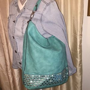 Turquoise purse new. Perfect condition.